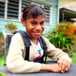 A girl from PNG in her new wheelchair