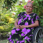 PNG woman in her new wheelchair