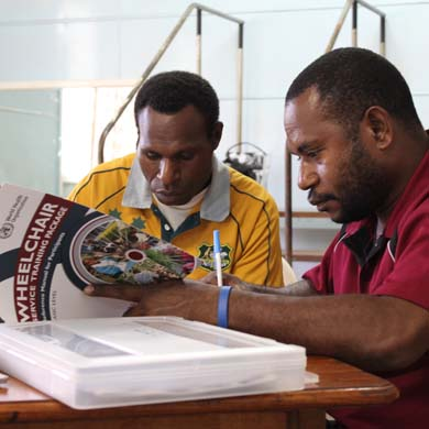 Two trainees in PNG learn their training material!