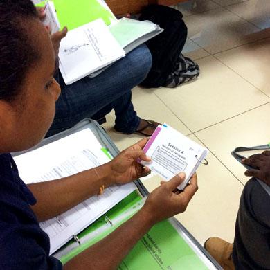 A trainee reading a walking aid training card