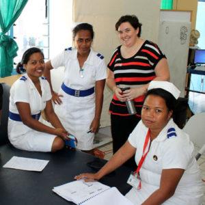 MA's and Kiribati staff looking at training materials.