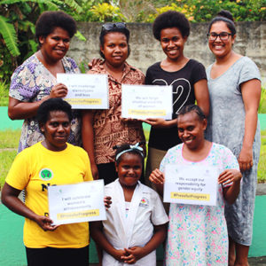 Vanuatu: A group of 7 women of different ages proudly hold their certificates and smile at the camera.
