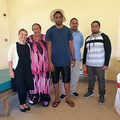 Okalina with her new cast shoes, standing next to her son, and MA prosthetist orthortist Narelle Cook and prosthetist orthotists.
