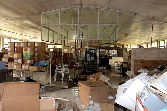 A photo of the derelict building before we began renovations. You can see boxes stacked high, and self care equipment stacked.