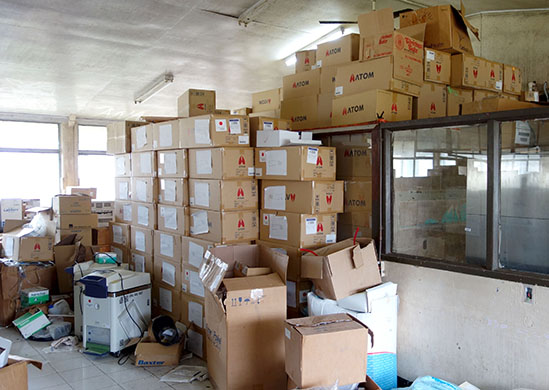 A photo of the derelict building before we began renovations. You can see boxes stacked high.