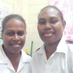 A picture of Angelina and Roselyn wearing their nurse uniforms.