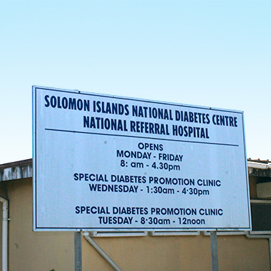 "A sign outside of a building reading ""Solomon Islands National Diabetes Centre National Referral Hospital"""