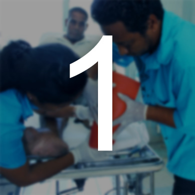 Two people measure a clients foot for an offloading device. The number 1 sits over the image.